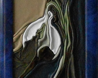 Snowdrop, leather picture on hardboard, blue PVC frame