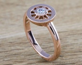Dharma wheel 14kt rose gold handcrafted engagement ring set with conflict free 0.10ct diamond in low bezel.