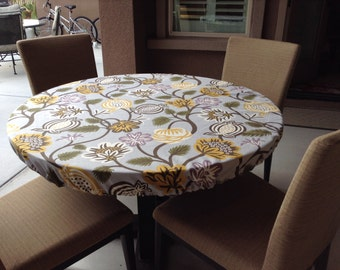 Custom decorator fitted round tablecloth, perfect for your outdoor or indoor round dining table.