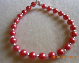 Bracelet, cranberry red small beads with small silver beads with silver lobster clasp