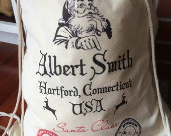 1 Santa Sack - Christmas Sack - Large Drawstring Canvas - Personalized Name and Location - Elf Approved Design - 17x20 - Made in the USA
