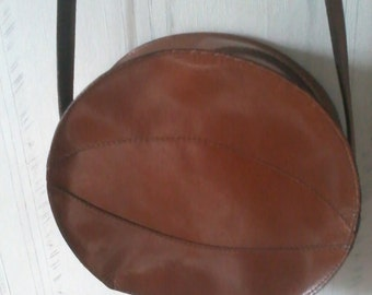 bag with shoulder strap circular leather brown colors