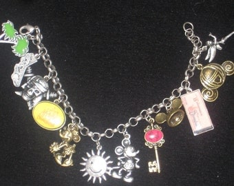 12 Disney Charm Bracelet marked 'Disney China' Mickey and Minnie Mouse, California and Many Others