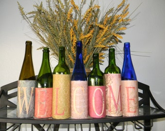 WELCOME Repurposed wine bottles