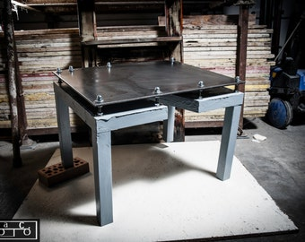 Coffee table with wooden spatula cement floor in iron ore.