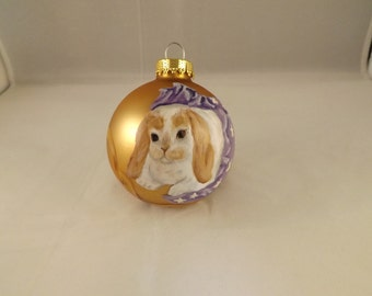 Holland Lop in a gift box painted on a gold matte glass Christmas ornament