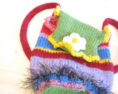 rainbow colors bitsee bag with white daisy on flap....converts easily from backpack to shoulder bag