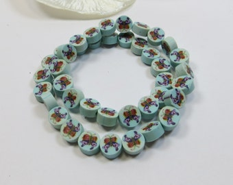 Strand Blue Butterfly Detail 7x4mm Polymer Clay Cane Slice Beads - DESTASH