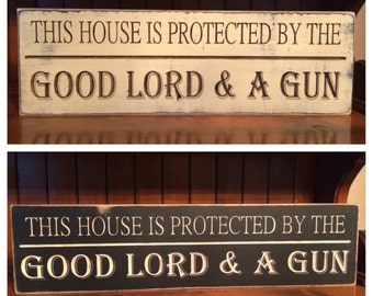 "Custom Carved Wooden Sign - ""This House Is Protected By The Good Lord & A Gun"" - 24""x6"""