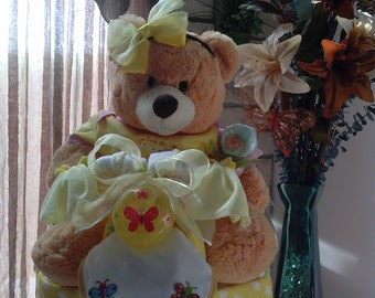 Baby girl yellow tricycle diaper cake