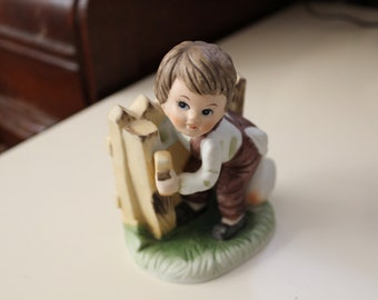 Vintage little boy and a duck figurine