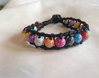 Handmade Black Leather Beaded Bracelet. Different coloured beads with silver speckles. Length is 8.5 inches.