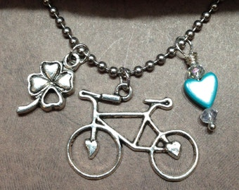Bicycling With Love And Luck Three Silver Plated Charm Necklace With Stainless Steel Ball Chain.    FPN-2
