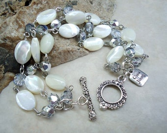 White Mother of Pearl Bracelet.Triple Strand.Crystals.Beach Wedding.Toggle plated in sterling silver.Beadwork.Bridal.Bridesmaid. Handmade.