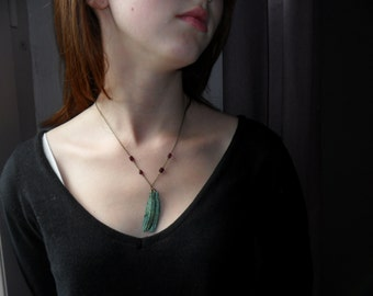 Green feather grey and garnets pendant