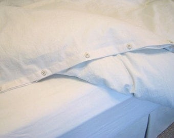 how to put on a duvet cover with buttons