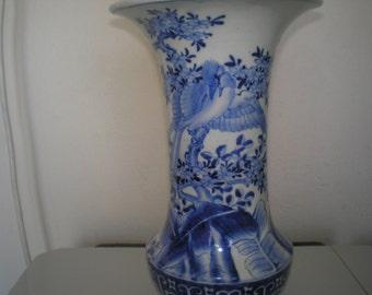 An antic Arita blue Japenese trompette vase