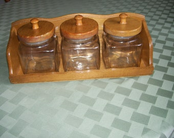 items similar to 4 vintage clear glass canisters storage jars with wood lids on etsy. Black Bedroom Furniture Sets. Home Design Ideas