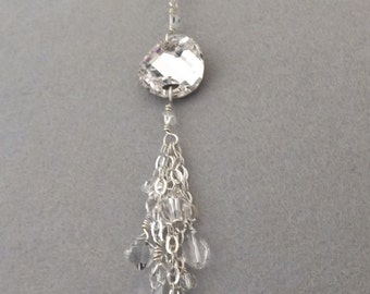 "30"" Sterling silver chain cluster neclace made with clear Swarovski crystals."