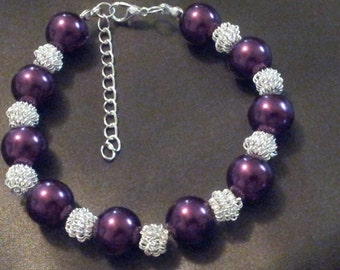 A purple and silver pearl bracelet