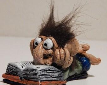 Troll Reading a Book
