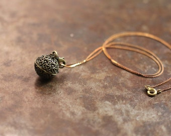 Intricate Brass Ball Opening Locket Necklace