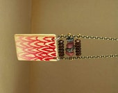 Hand printed wood pendant with rhodonite necklace
