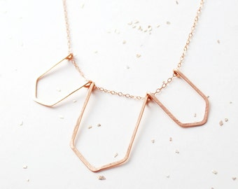 3 geometric silhouette necklace