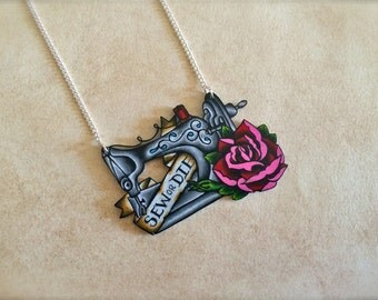 Vintage tattoo style sewing machine and red and pink rose with Sew or Die banner necklace with silver plated chain