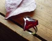 Superhero. Vintage Upcycled Red Glass Super Manly crest and antiqued brass ring.