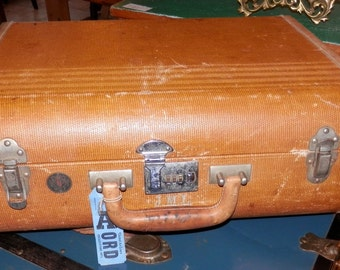 vintage canvas covered Wilt of Chicago suit case