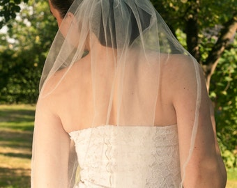 Handmade bridal off-white tulle veil hand embroided with many swarovski stones and beads on comb made to order