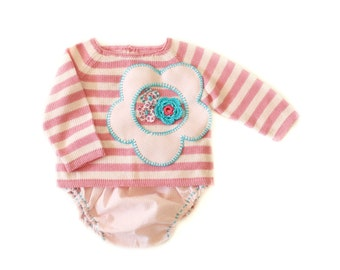 A knitted striped sweater with diaper cover in pink . 100% cotton. 1-3 months.