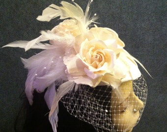 Bridal headpiece fascinator hat with birdcage veil, flowers and feathers, made to order