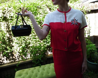 Little Miss Jet-setter 1950's suit in brilliant red.