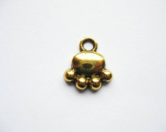 10 Paw Charms in Gold Tone - C420