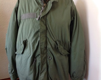 Green military jacket with removable deep cold lining