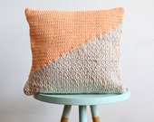 hand knitted cushion, grey with peach No.4