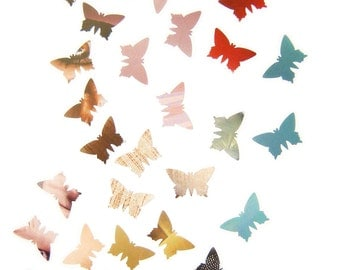 Mix of colorful butterflies, cardboard punches confetti
