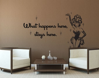 Giant Vegas Showgirl with what happens here wall decal quote.
