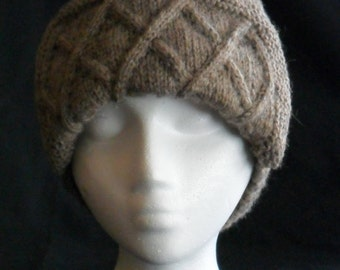 Hand Knit Aviator hat with cable stitch body.