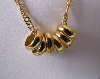 Vintage Six Ring Pendant on a Twisted Curb Chain