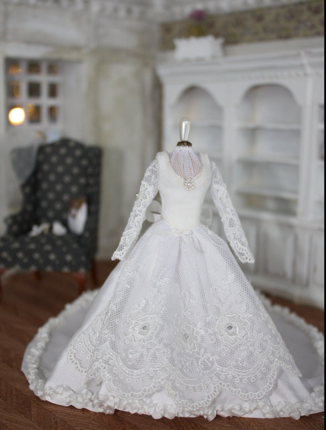 Handmade Wedding Dress In White Silk On A Mannequin And Shoes