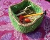 Unusual green bowl: Crocheted jute bowl with bright green eyelash yarn.