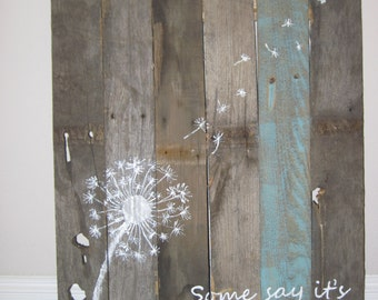 Some say its just a weed Dandelion ... old wood sign