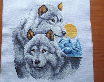 Finished cross stitched wolves