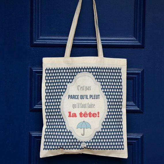 """Tote bag """"C'est pas parce qu'il pleut qu'il faut faire la tête"""""""