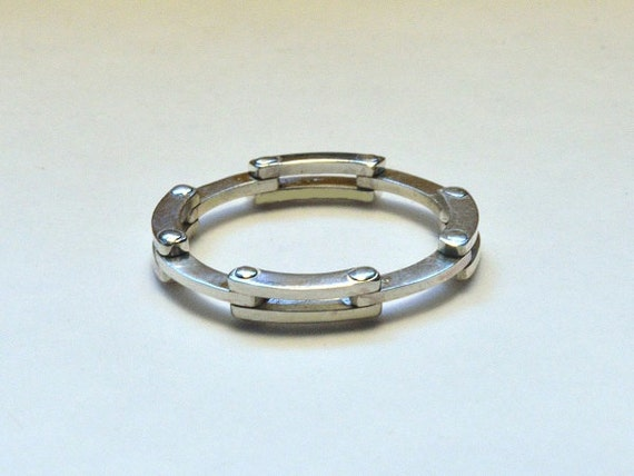 kinetic ring collapsing hinged band folding by