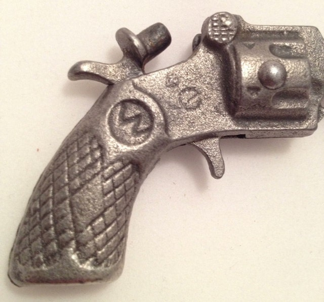 Vintage cast iron toy miniature cap gun by insideoutsiderart