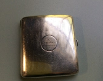 "Cigarette holder, cigarette case silver stamped. With dedication ""To my dear Husband"""